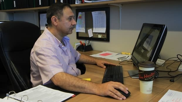 Alaa 'Al' Al-Gadhi sits at his computer at ARC Engineering Inc. in Stoney Creek, where he's worked for the past six months.