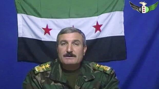 Syrian Commander Riad al-Asaad, who heads the Free Syrian Army appears on a video posted on the group's Facebook page. Free Syria Army/Associated Press