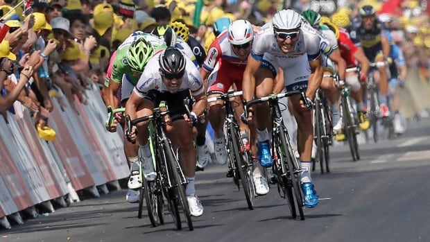Marcel Kittel of Germany, right, sprints towards the finish line ahead of Mark Cavendish of Britain, left, to win the twelfth stage of the Tour de France cycling race over 218 kilometers (136.2 miles) with start in in Fougeres and finish in Tours, western France, on Thursday.
