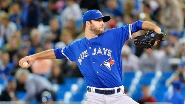 Toronto Blue Jays starting pitcher Brandon Morrow works against the Atlanta Braves on Tuesday. He lasted two innings before he left with forearm tightness.