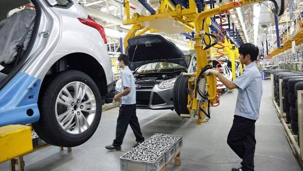 In this photo released by Ford Motor Co., workers assemble a car at a new plant in Chongqing in August. Global automakers are looking to China, the biggest market by number of vehicles sold, to drive revenues amid weakness elsewhere.