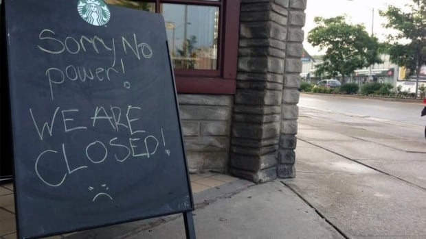 A coffee shop without electricity at Bloor and Royal York posts a sign informing customers it's not brewing any coffee due to power outages. Hydro One says between 5,000 and 10,000 customers, primarily in the west end, are in the dark.