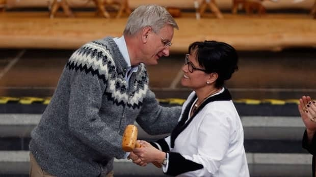 Sweden's Foreign Minister Carl Bildt hands the gavel, which symbolizes handing the chairmanship of the Arctic Council, to Canada's Minister of the Arctic Council Leona Aglukkaq, at the Arctic Council ministerial meeting, in Kiruna, Sweden, Wednesday.
