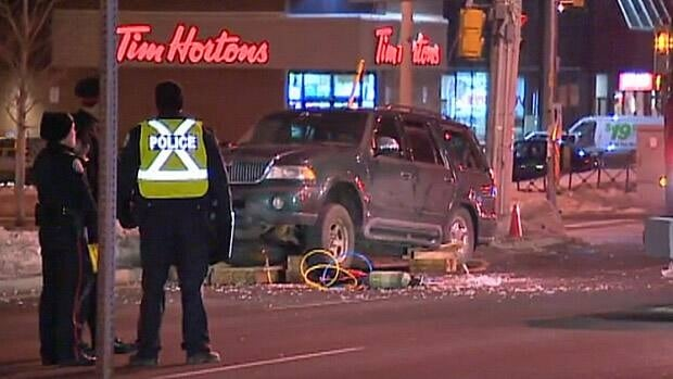 Toronto police say a woman was struck and subsequently pinned by a Lincoln Navigator on the west side of the Eglinton Avenue East and Midland Avenue intersection on Monday evening.