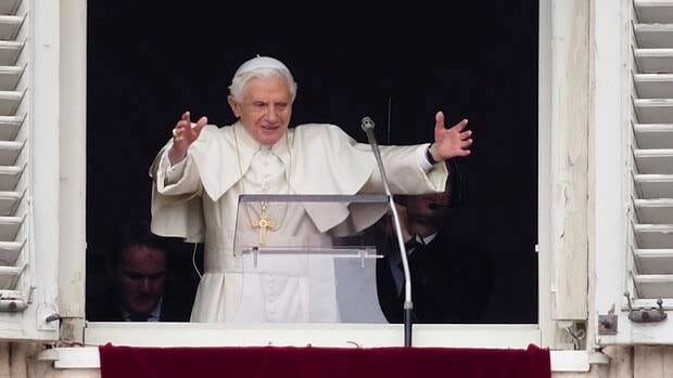 Pope Benedict XVI appears for his last Angelus noon prayer before a crowd in St. Peter's Square at the Vatican on Feb. 24.