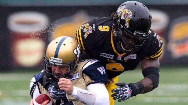 Renauld Williams, right, spent the last two seasons with the Hamilton Tiger-Cats.