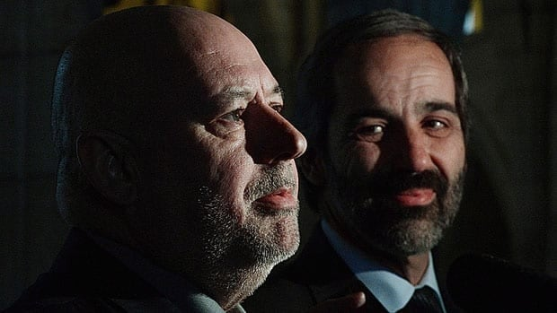 The NDP is putting pressure on Claude Patry, left, with Bloc Québécois Leader Daniel Paillé, through a robocall to his constituents. Patry crossed the floor to join the Bloc last week.