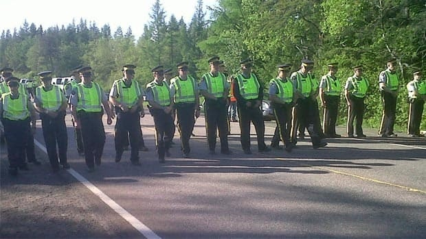 RCMP officers watch a recent anti-shale gas protest in Kent County.