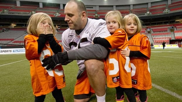 Ben Archibald of the B.C. Lions, seen during the 2011 Grey Cup week with triplet daughters Kaylee, Tessa and Ashlyn, left to right, hasn't missed a start in the last two seasons.