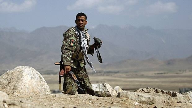 An Afghan National Army soldier takes his position at the site of an attack on the outskirts of Kabul. The Taliban has hit selected targets in the national capital but has usually been repelled quickly.