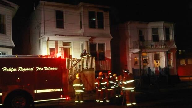 There were five trucks and more than a dozen firefighters on the scene of a white house on fire at 1977 Preston Street Sunday evening.