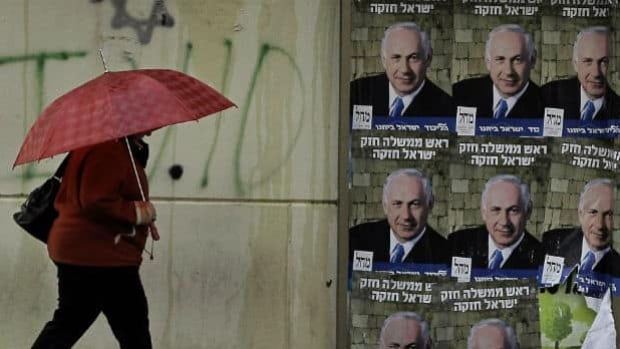 Election posters and more nationalistic rhetoric have dominated the campaign that sees Israeli voters go to the polls on Tuesday. Prime Minister Benjamin Netanyahu, shown here, is expected to be coalition-shopping later in the week.