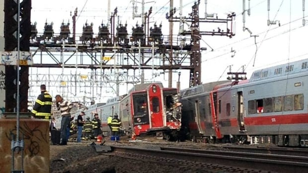 Emergency workers arrive at the scene of a train collision in Fairfield, Conn. The railroad says the accident involved a New York-bound train leaving New Haven