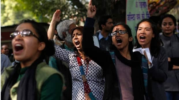 Demonstrators shout slogans near India's parliament in New Delhi on Thursday, demanding lawmakers implement harsher punishments and quicker trials for rape cases.