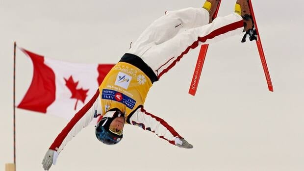 In this file photo Jan. 29, 2012, Olivier Rochon of Gatineau, Que. jumps to the win in the aerials finals at the Canada Post Grand Prix Freestyle Ski World Cup in Calgary.
