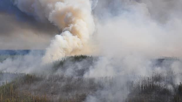 One lane of N.W.T.'s Highway 1 connecting Dehcho communities to Yellowknife and Alberta reopened to traffic at 3 p.m. Wednesday after a closure due to heavy smoke from a nearby forest fire.