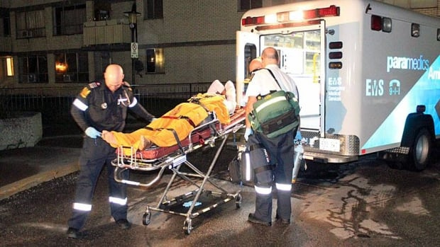 A man is taken away on a stretcher following a shooting on Dixon Road near Islington Avenue early Tuesday morning.