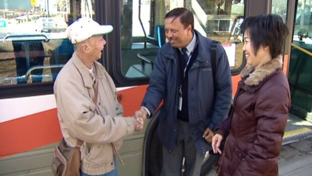 Shirley Loi and her father, who lost his wallet containing $1,200 on a bus Wednesday, meet with the Calgary Transit driver who returned the lost item.