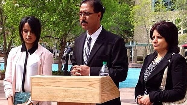 Coun. Amarjeet Sohi, flanked by his daughter Seerat and his wife Sarbjeet, announces Tuesday he will not run for mayor as widely expected.