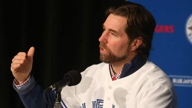 R.A. Dickey answers questions from the media as he is introduced by the Toronto Blue Jays at a press conference at Rogers Centre in Toronto in January.