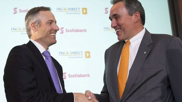 Last year's acquisition of ING Direct Canada, whose CEO Peter Aceto, left, is seen above shaking hands with Scotiabank group head for Canadian banking Anatol von Hahn, helped increase Scoitabank's second-quarter income by $141 million.