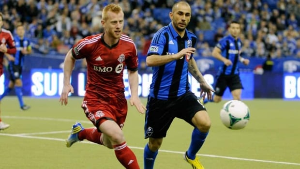 Montreal Impact forward Marco Di Vaio, right, gave the team a 2-0 lead over Toronto FC in the first-half on Saturday in Montreal.
