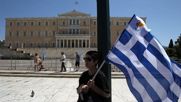A woman holds Greek and small Cypriot flags during a May 1 rally in front of the Parliament in Athens. The Greek capital is the focus of TIFF's 2013 City to City program, inspired by young filmmakers who have reinvigorated the troubled country's movie scene.