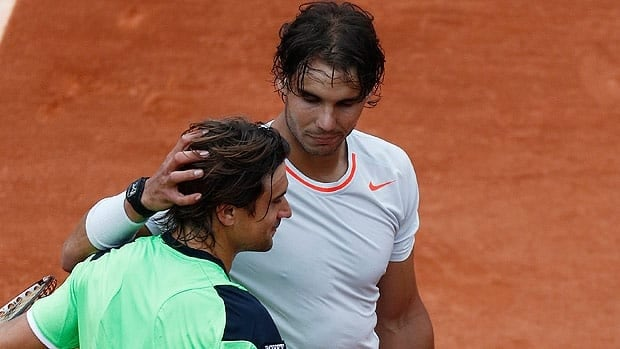 Rafael Nadal consoles compatriot David Ferrer after Sunday's French Open final, with the runner-up ahead of the champion in the latest rankigns.