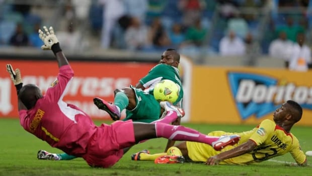 Nigeria's Brown Ideye, centre, scores past Mali's goalkeeper Mamadou Samassa, left, and Mali's Molla Wague, during their African Cup of Nations semifinal in Durban, South Africa on Wednesday.