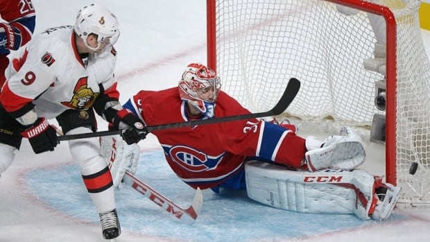 Montreal Canadiens goaltender Carey Price makes this save against Ottawa Senators' Sergei Gonchar (not shown) as one of at least three key saves in the second period during Game 2.