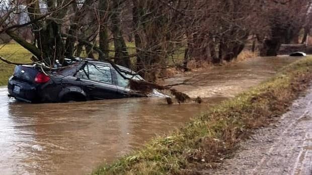 Flooding on Jan. 12 sent this car into a ditch on Airport Road East. City councillors are examining how to prevent flooding in areas such as Glanbrook and Stoney Creek.