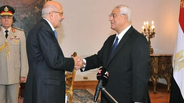 Mohamed ElBaradei, a leader of the National Salvation Front shakes hands with interim President Adly Mansour after being sworn in as vice president in Cairo, Egypt.