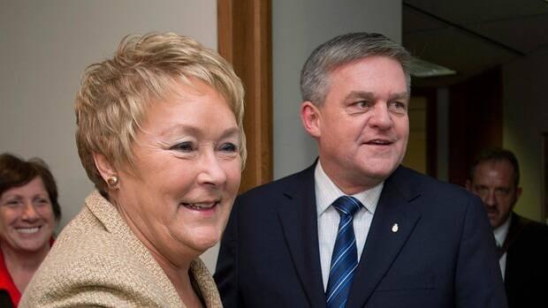 Quebec Premier Pauline Marois greets New Brunswick Premier David Alward in her office in Montreal on Feb. 18, 2013.