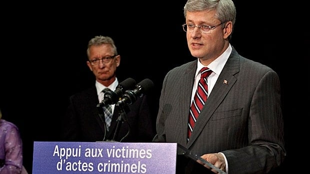 Senator Pierre Hugues Boisvenu, left, who lost his daughter in a crime, has appeared frequently with Prime Minister Stephen Harper and other ministers to promote government measures to support victims of crime.  Since splitting from his wife, the senator has lived a only short drive from Parliament Hill but still claims living expenses based on his previous marital home.