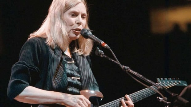 Folk singer-songwriter Joni Mitchell, seen here in Vancouver in 1998, will be be honoured at this summer's Luminato arts festival in Toronto.