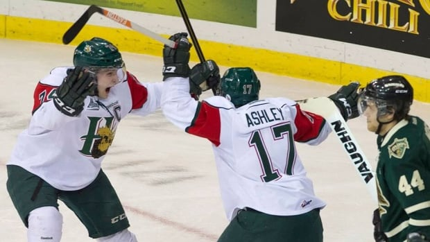 Mooseheads right winger Stefan Fournier, left, and right-winger Darcy Ashley celebrate a goal as Knights defenceman Dakota Mermis looks on in the first period. Ashley scored twice and added an assist in a 9-2 Halifax victory.