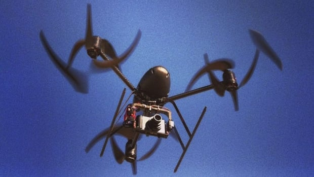 An unarmed drone owned by the Mesa County Sheriff's Department flies over a Colorado airfield. FBI director Robert Mueller says that as drones become omnipresent airspace use and privacy will be among the issues worthy of debate.
