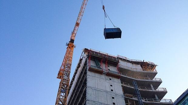 The injured worker was lowered down 10 storeys by crane.