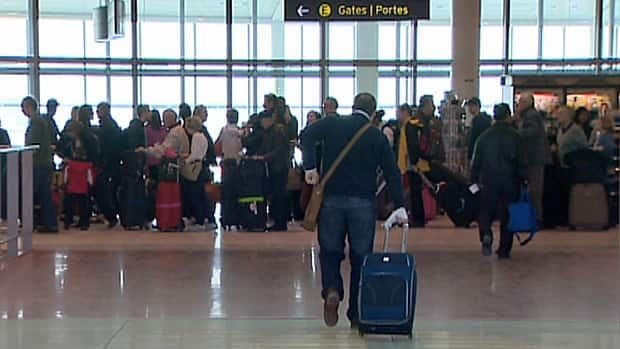 Some passengers were rebooking flights out of Toronto Pearson International Airport on Sunday after delays that occurred the night before.