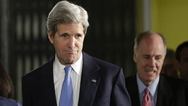 Secretary of State John Kerry, left, followed by National Security Advisor Tom Donilon, arrives in Jerusalem, Israel, Wednesday, March 20, 2013.