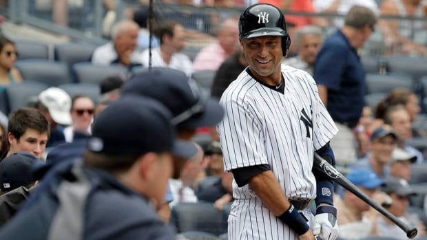 New York Yankees shortstop Derek Jeter grins as he looks back at the dugout before he batted for the first time against the Kansas City Royals in the first inning of their MLB American League baseball game at Yankee Stadium in New York on Thursday.