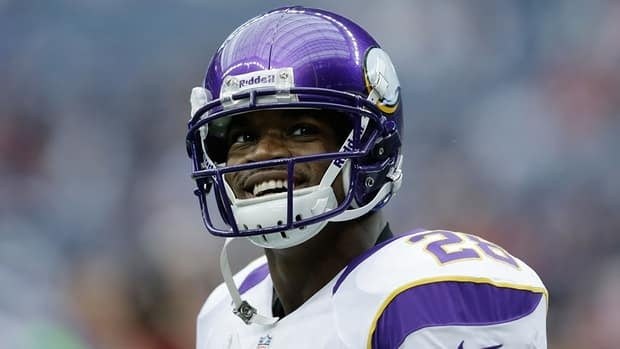 The Minnesota Vikings running back Adrian Peterson rushed for 2,109 yards, nine short of Eric Dickerson's rushing record.