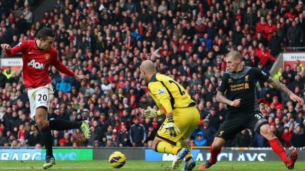 Robin van Persie (20) of United heels the ball in a 2-1 triumph over Liverpool last Sunday.