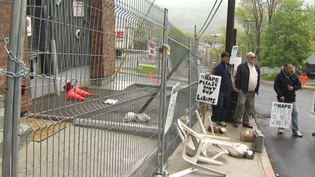 A fence was put up around the Labatt brewery in downtown St. John's after the company said striking workers took the dispute too far by making signs with the names and home addresses of replacement workers.