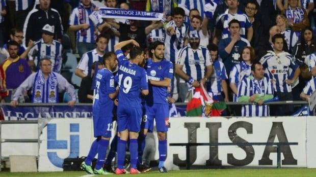 Getafe players celebrate after scoring their first team's goal during against Real Sociedad at the Col. Alfonso Perez stadium in Getafe Monday.