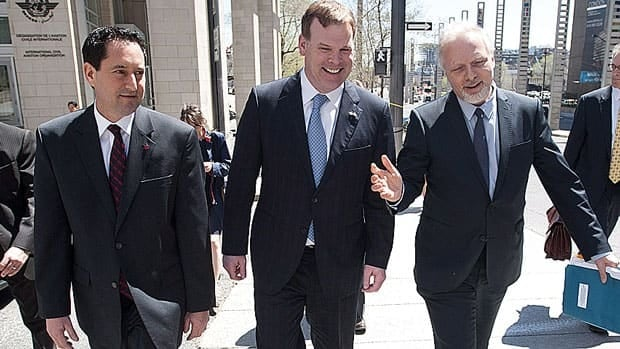 Montreal Mayor Michael Applebaum, left, Foreign Affairs Minister John Baird, centre, and Jean-François Lisée, Quebec's international relations minister, leave a 'Team Montreal' meeting at ICAO's Montreal headquarters May 3.