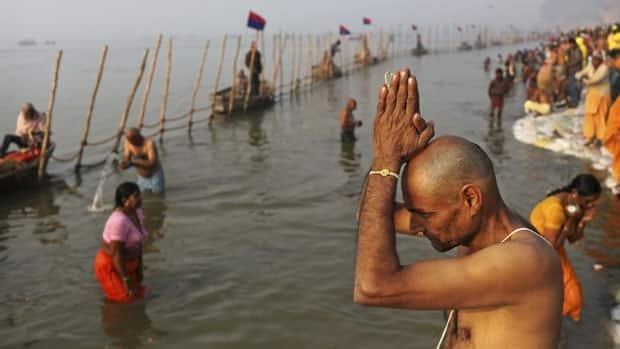 Indian Hindu pilgrims bathe at Sangam, the confluence of the rivers Ganges, Yamuna and mythical Saraswati, ahead of the Maha Kumbh Mela in Allahabad, India, Sunday.