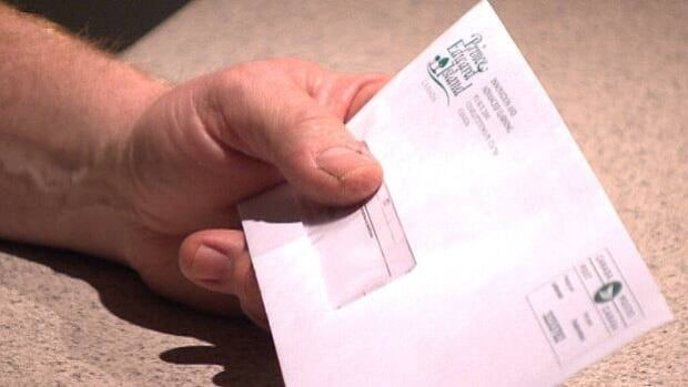 Tracey MacDonald's thumb covers the window where his son's Social Insurance Number shows through the window in a P.E.I. government mailing.