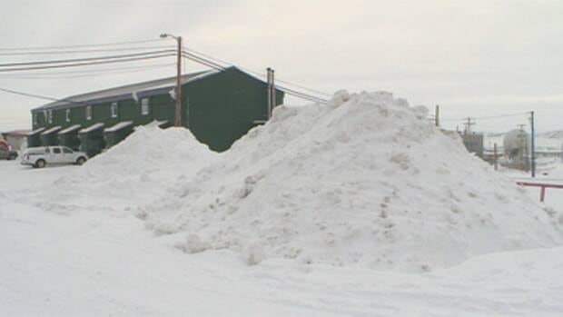 Iqaluit city council has received complaints from residents about the rock and post barriers separating pedestrians from traffic, and about the height of snow piles along roads this winter.