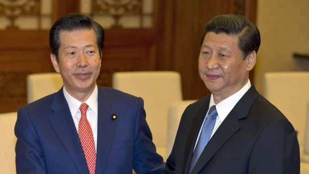 The meeting between Natsuo Yamaguchi, left, leader of the New Komeito party from Japan, and Chinese leader Xi Jinping on Friday appeared to dial back some of the tension around the island dispute between the two nations.